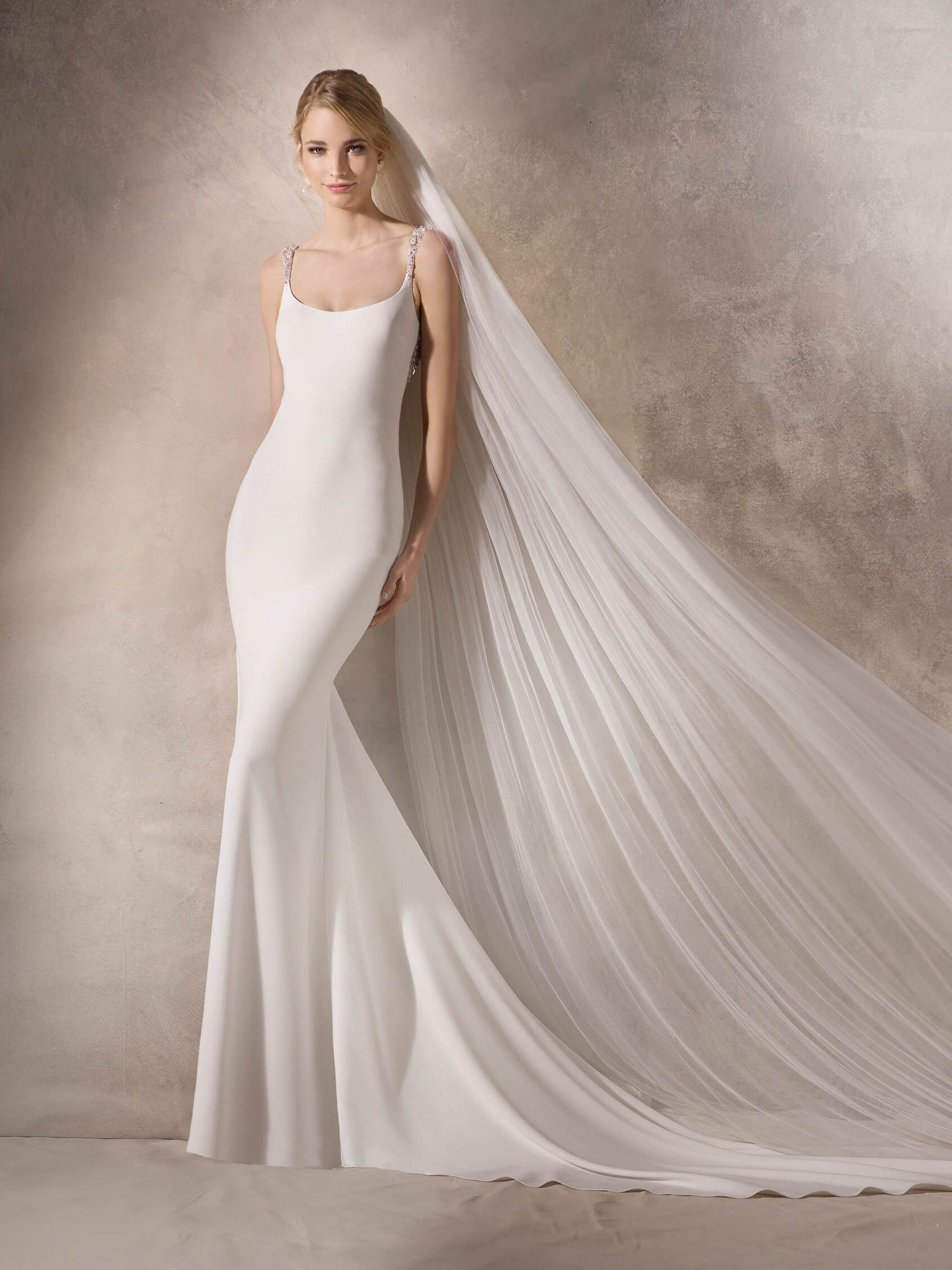 14cede02e4ff HAZEL is a beautiful minimalist, mermaid wedding dress. With a round neck,  made in crepe and tulle with a gemstone back and straps