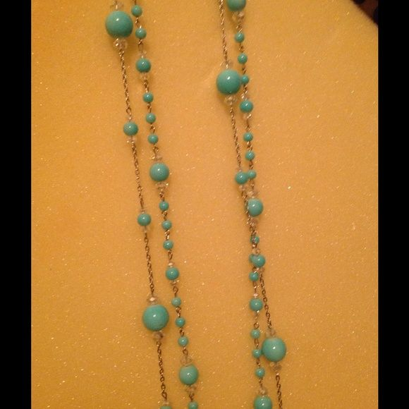 Teal long necklace. This is a double strain necklace with small earrings. Made by Ole. Jewelry Necklaces