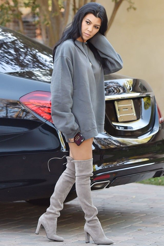 6935b03b15c17 Kourtney Kardashian wearing Stuart Weitzman The Highland Boot, Fan  Merchandise Yeezus Tour Sweatshirt