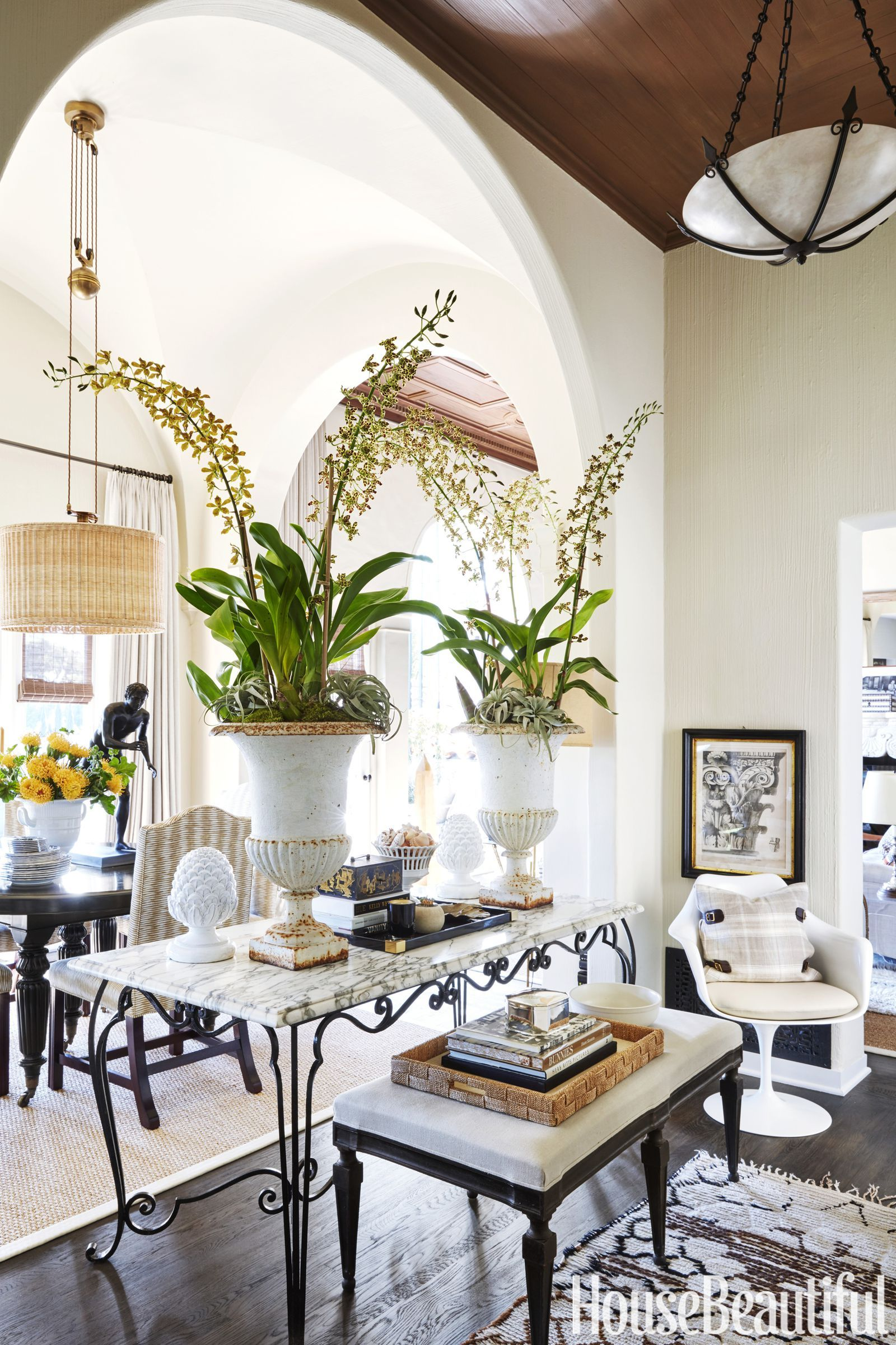 This Seven Story Spanish Bungalow Is Overflowing With Natural Light Foyer Decorating Wicker Dining Chairs Interior Design Rustic