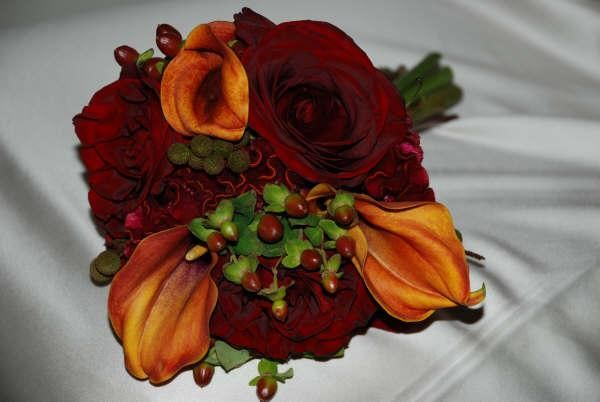 With orange callas