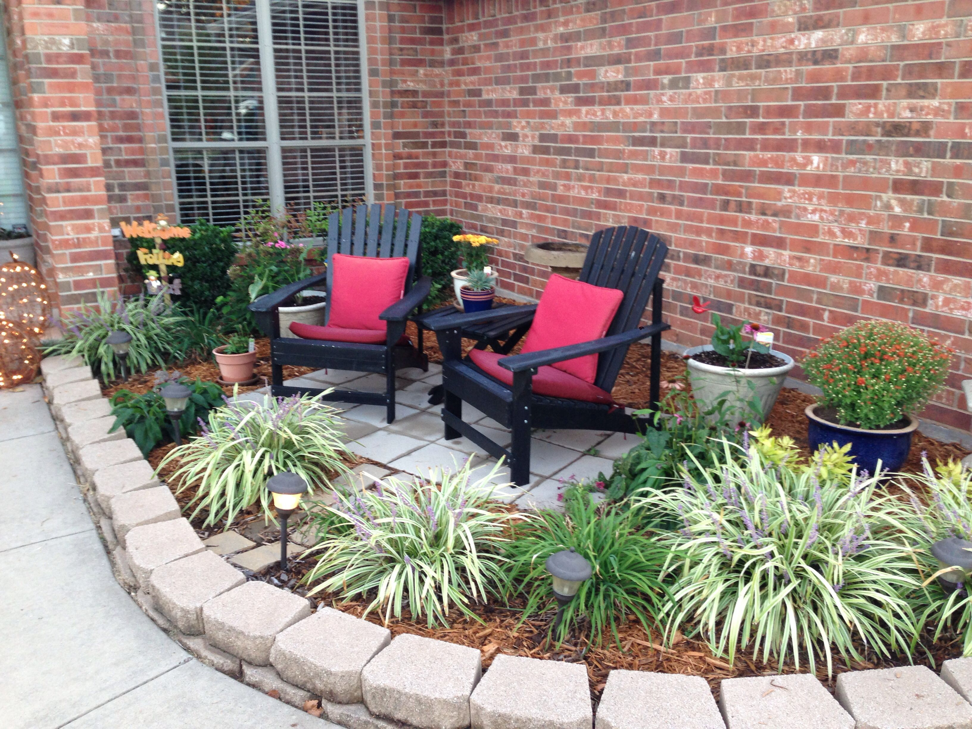 Pavers in flower bed seating area. (With images