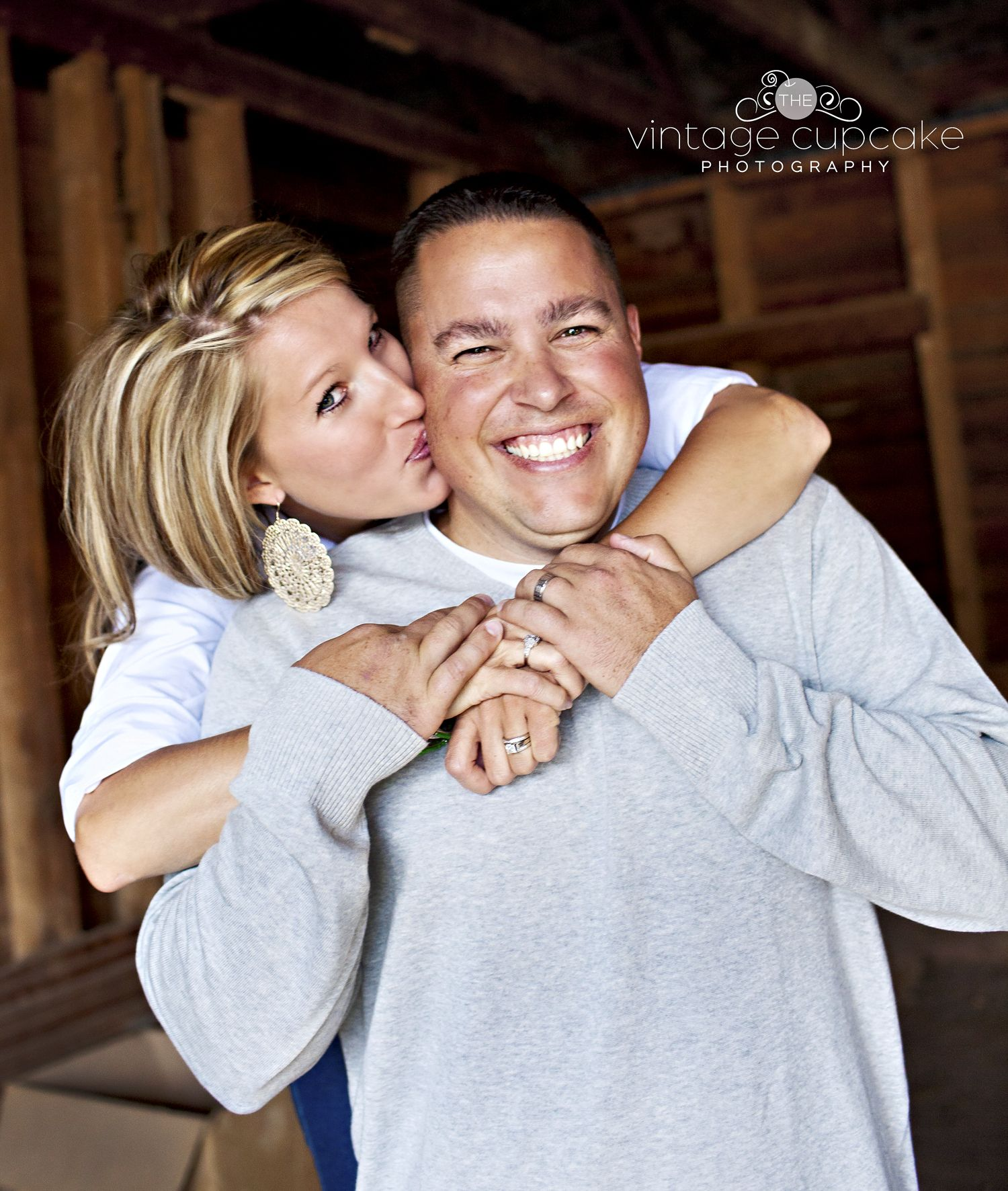 Wedding Poses With Parents: Husband And Wife Kissing In Old Barn For Family Fall Photo