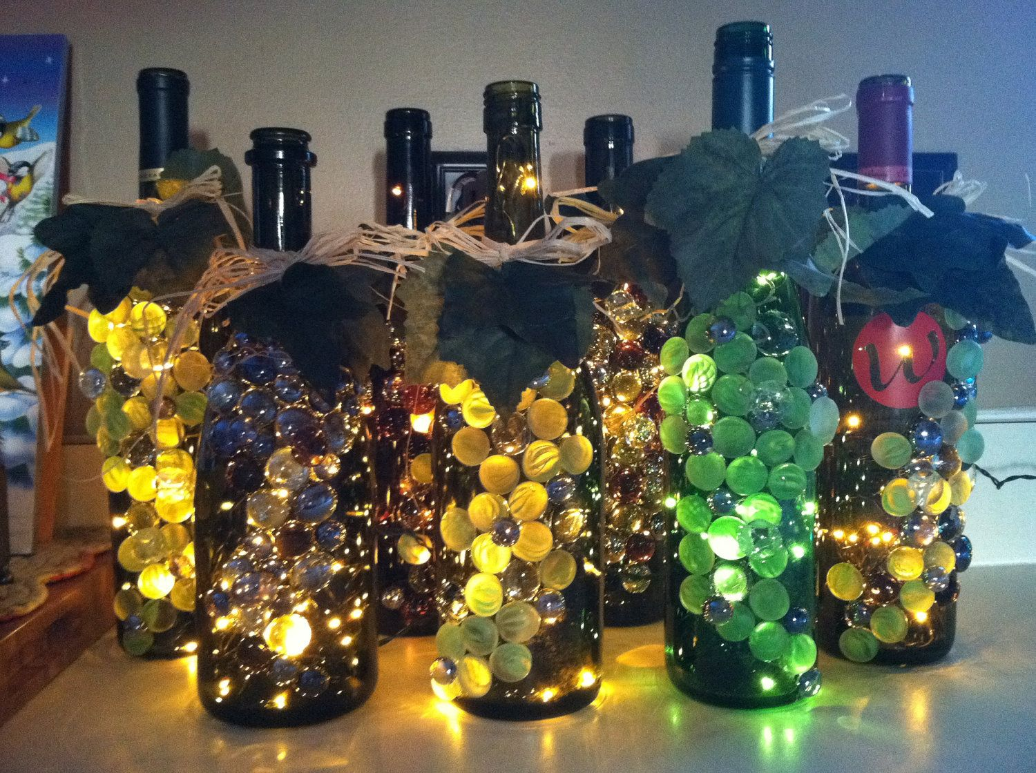 wine bottle lights wine bottle lights by kmarieoriginals. Black Bedroom Furniture Sets. Home Design Ideas