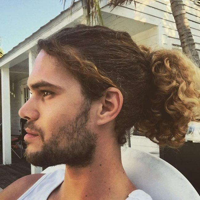 Curly Hair Pulled Back With Beach Blonde Tips Mens Ponytail Hairstyles Long Hair Styles Men Blonde Tips