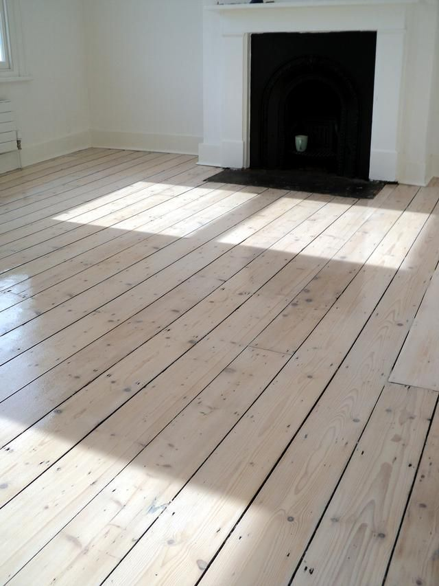 Original pine floor after sanding staining with white