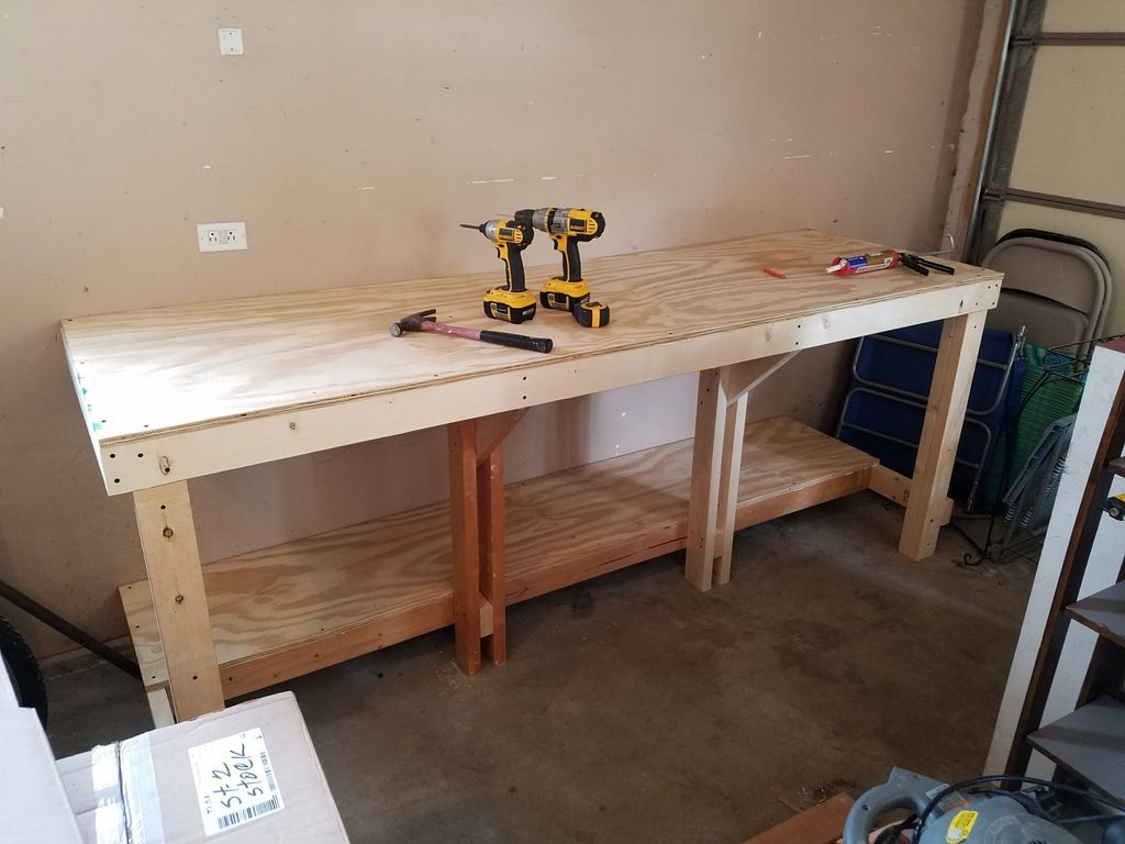Simple Workbench One 4x8 Sheet Of 3 4 Plywood And About 10 2x4s R Workbenches Workbench Garage Work Bench Wooden Pallet Table