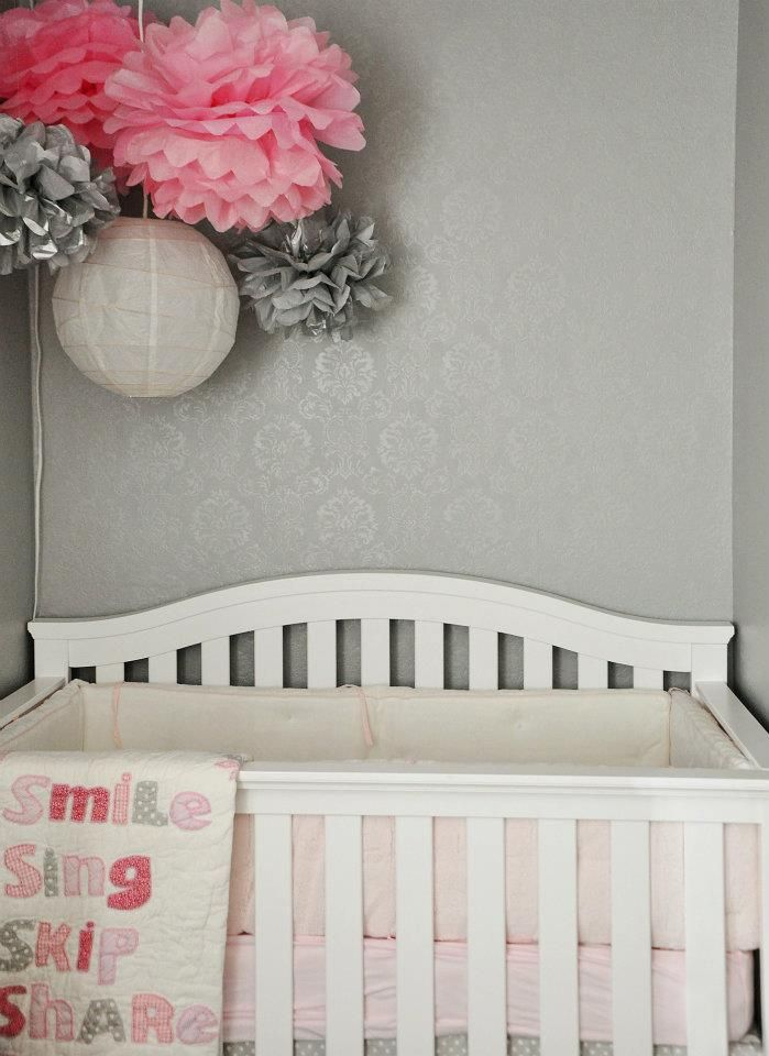 This room is accented with pink, the light pink and the grey make