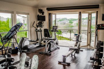 Excercise room - traditional - Home Gym - Dallas - Kitty Raulston-Thomas Interior Designs What a view while you work out! The Nano door system opens completely for a lake breeze off the lake. Set on your balcony, relax and cool off. Photos by Blackall Photography