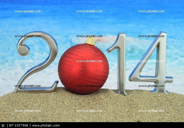 http://www.photaki.com/picture-new-year-2014-with-christmas-ball-on-the-beach_1037904.htm