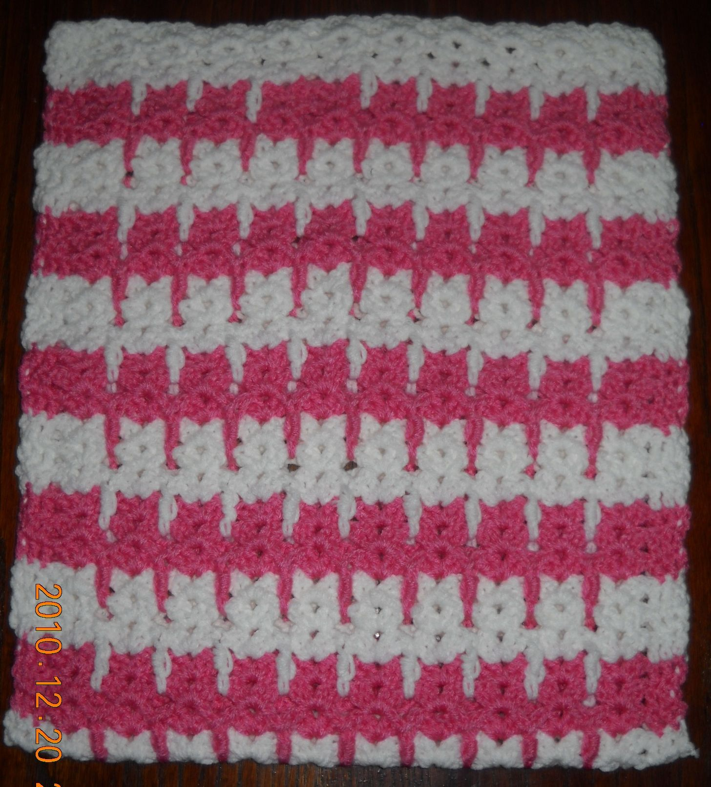 Pink and white kitty cat nap mat, for fighting against kitty cancer.