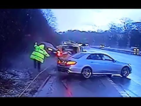 Near-miss for police officer as car skids out of control on motorway