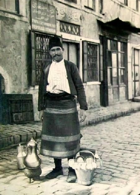 STREET SELLER: Salepçi (seller of the salep beverage). Istanbul, early 20th century. Salep is a flour made from the tubers of the orchid genus Orchis. These tubers contain a nutritious, starchy polysaccharide called glucomannan. Salep flour is consumed in beverages and desserts.