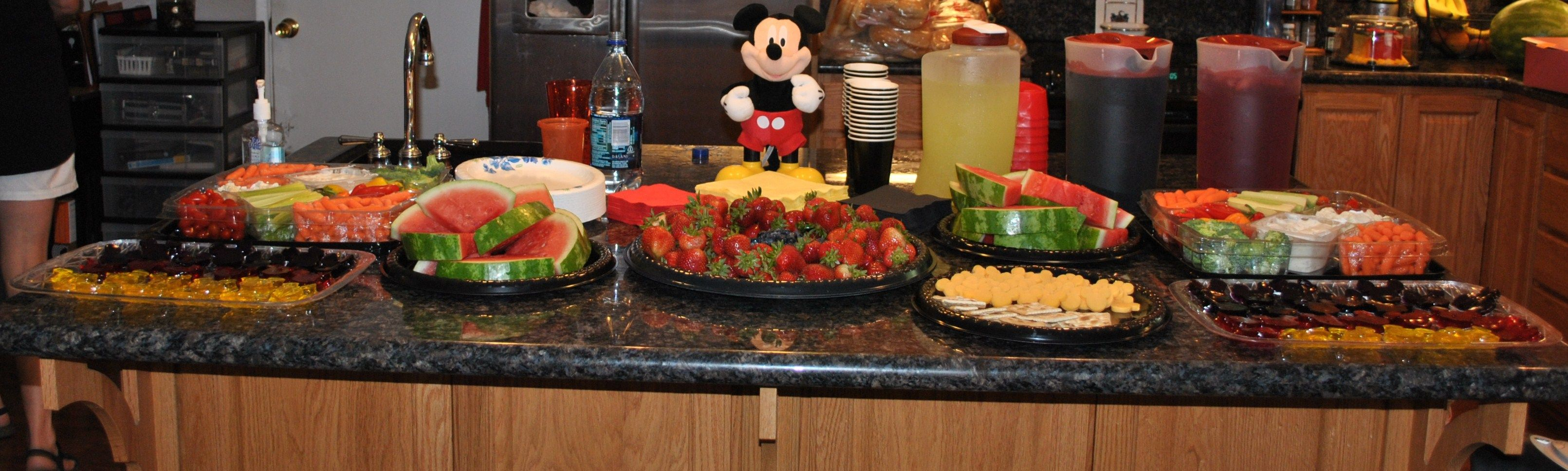 Emma's Mickey Mouse themed 2nd Birthday Party. I made Mickey Silhouette shaped jello jigglers and cheese with cookie cutters. I made Kool-Aid in grape, cherry and lemonade flavors to fit the color scheme as well as Mickey Silhouette shaped ice cubes with the same Kool-Aid flavors.