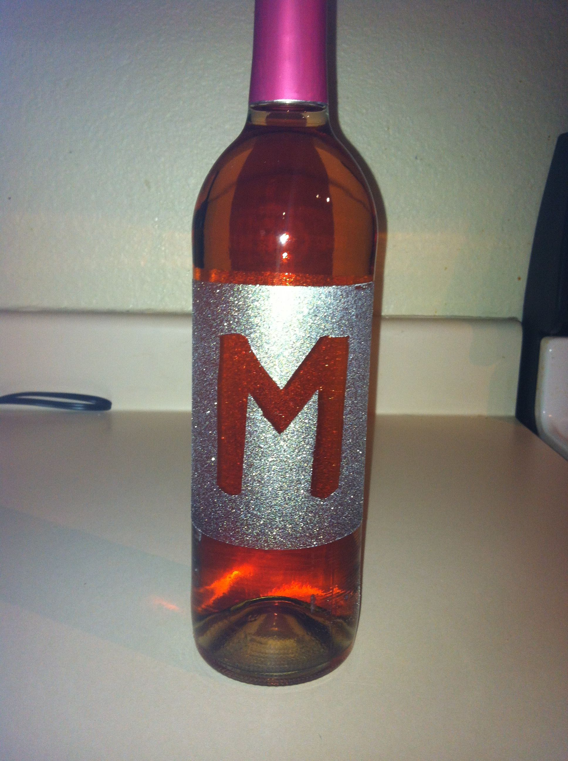 Took A Cheap Bottle Of Wine Scraped Off The Label Outlined It With Painters Tape And Spray Painted With Glitter Perfe Wine Bottle Wine Bottle Corks Bottle