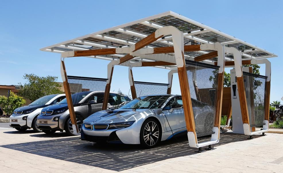 Bmw I Solar Carport Concept Pictures Photo Gallery Car And Driver Solar Car Bmw Design Car Charging Stations