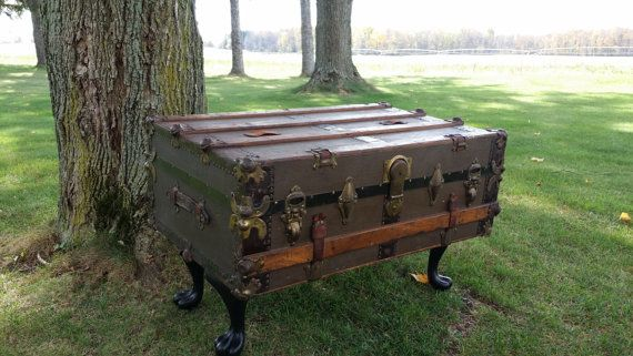 "This beautiful coffee table has been crafted from a fully repurposed steamer trunk. The dimensions are 35"" long X 21"" wide X 22"" tall."