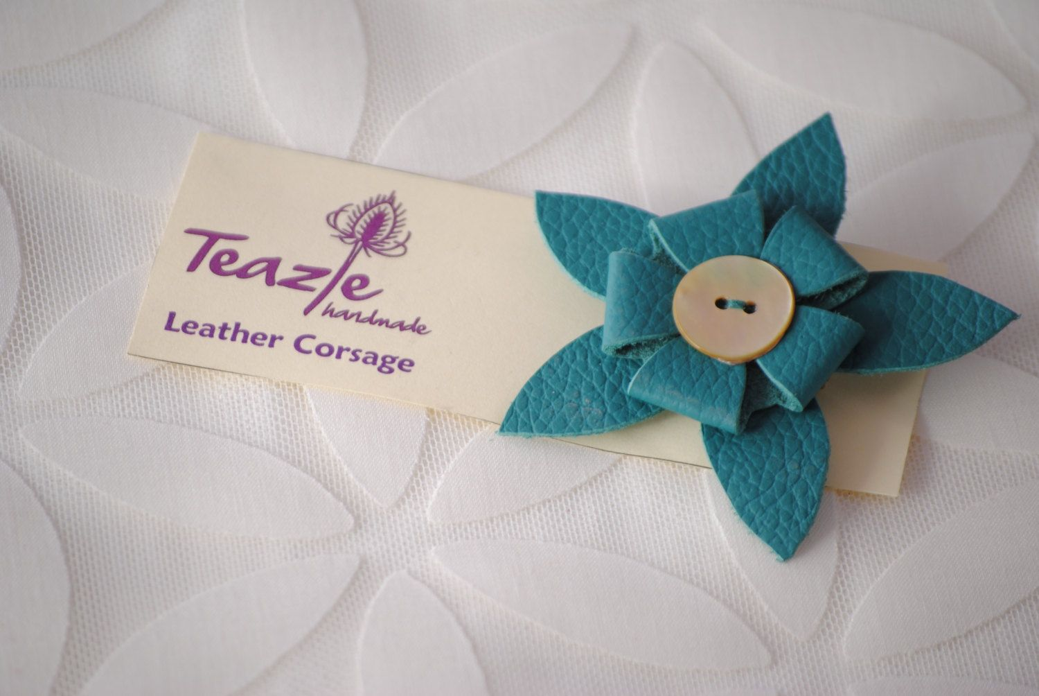 Leather flower corsage brooch with mother of pearl button and pin fastening. £8.00, via Etsy.