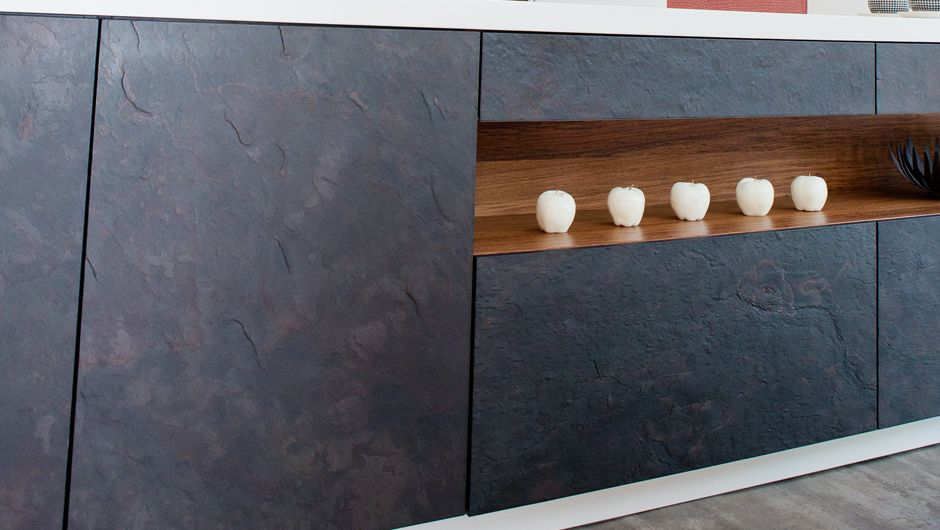 a black slate and white designer german kitchenrempp. the