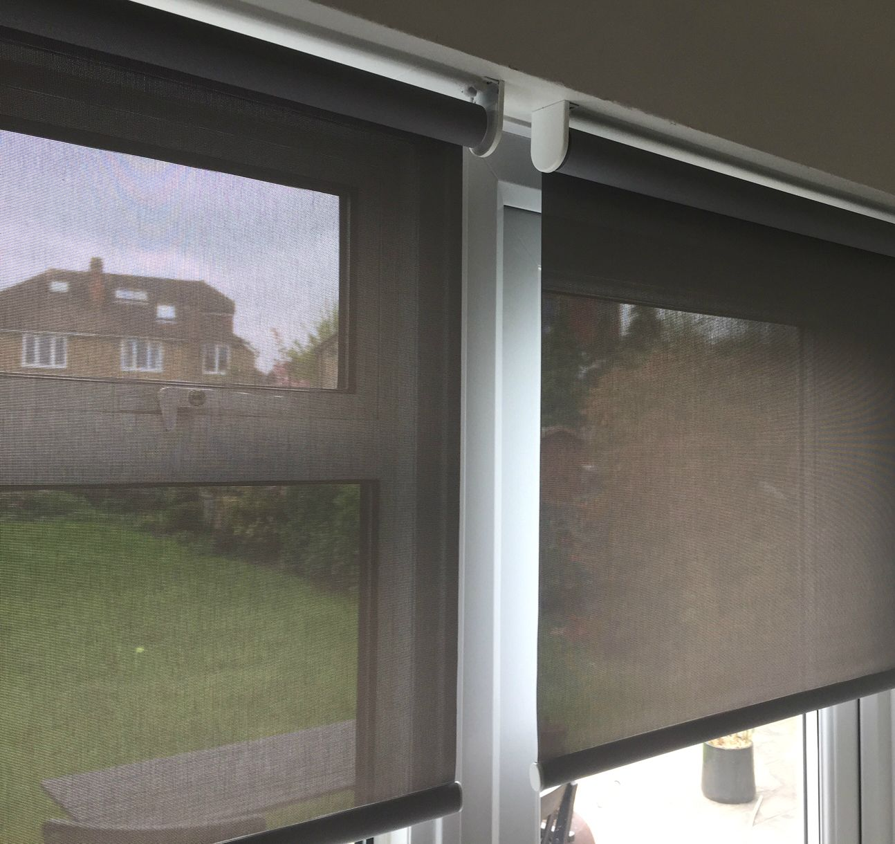 Close up of sunscreen roller blinds on door and window of