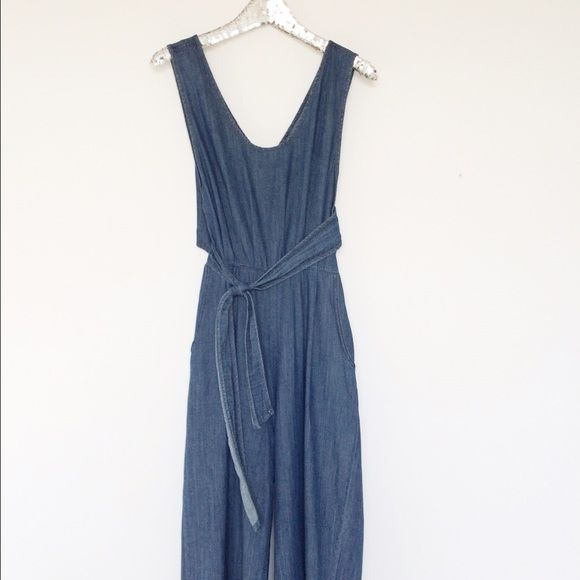 "NWOT Cropped  Denim Jumpsuit Jumpsuit has a cropped wide leg, 2 front pockets, cut out back and waist tie. Length 52"" Waist 30""-32"" 100%Cotton Ordered online, has never been worn Boutique Pants Jumpsuits & Rompers"