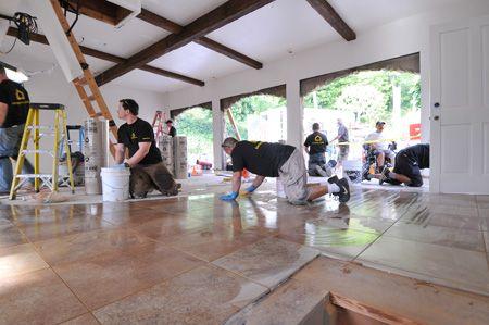 Finishing up the ceramic tile floor inside Jay Leno\'s garage ...