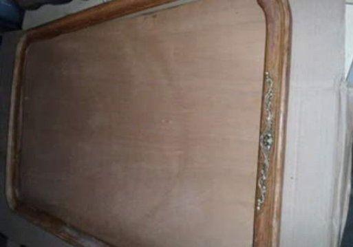 Proceso de restauración de un espejo de madera