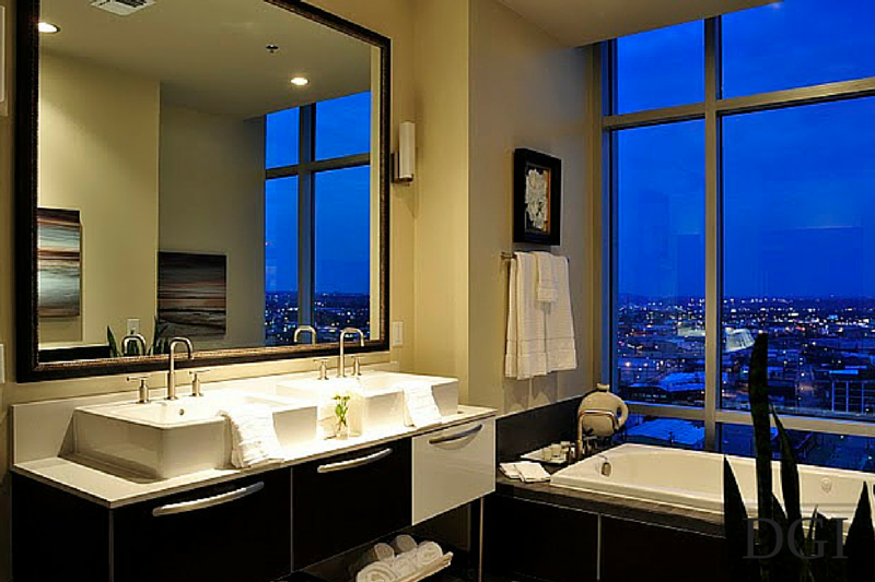 Modern, spacious bathroom overlooks miles of downtown Nashville. The night view…