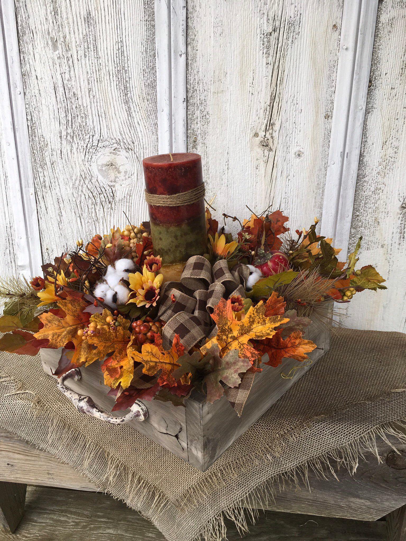 Fall pumpkin arrangement in an aged wood box autumn