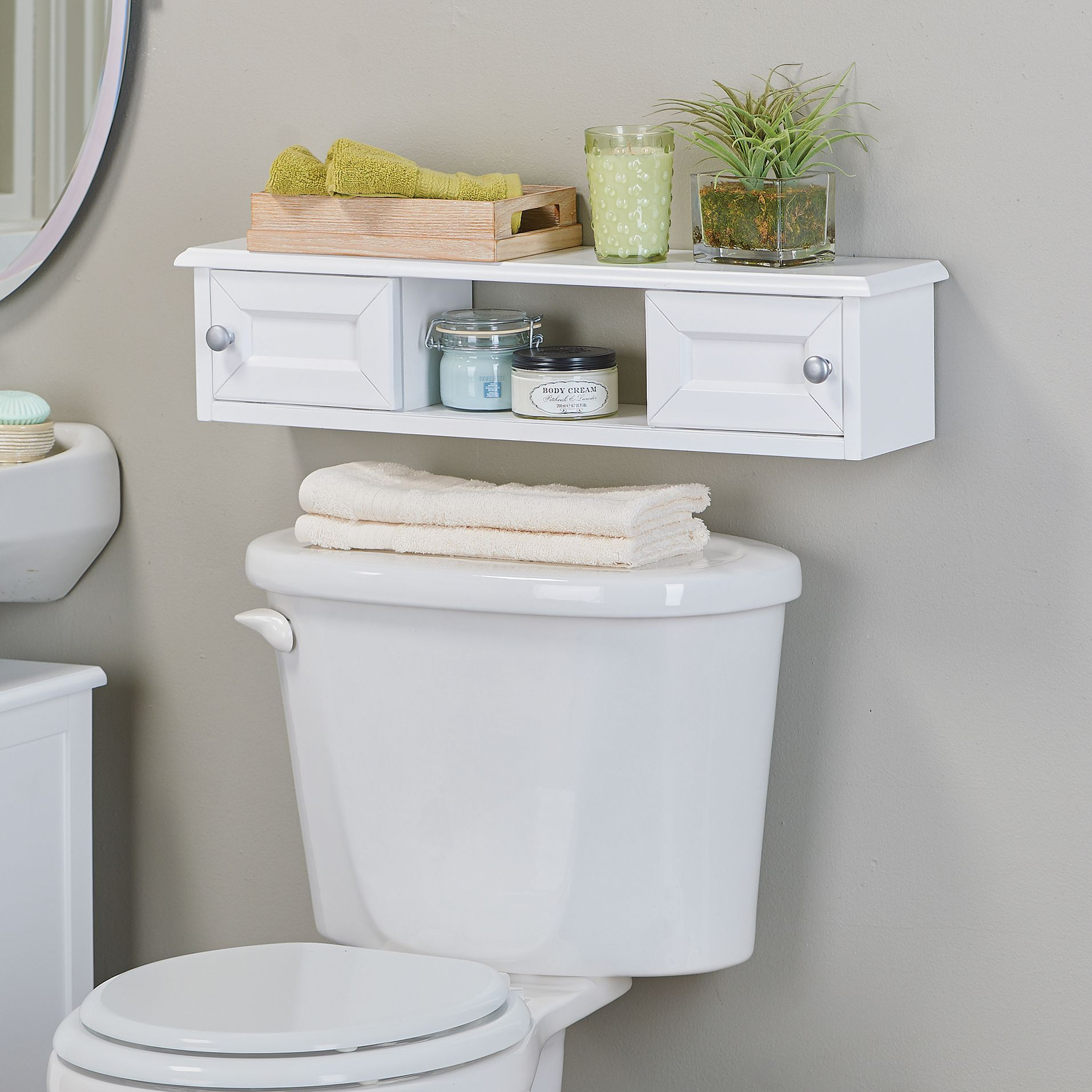 maximize storage space in your bathroom with our weatherby slim wall mounted cabinet this slim cabinet fits over a toilet or on any wall for extra bathroom