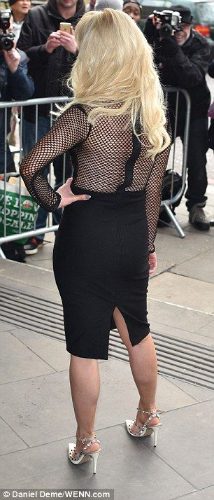 Busty: With its notably sheer mesh fabric between the bust, the design teased a peek of Jo...