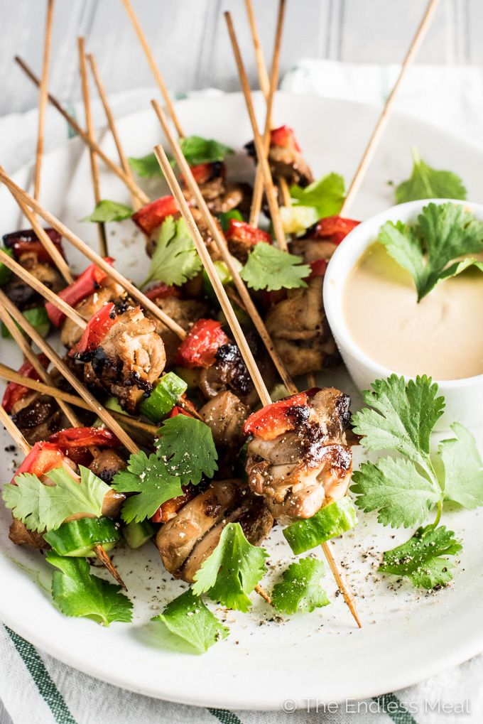 Mini Chicken Satay Skewers come with a side of Thai peanut dipping sauce and make the perfect appetizer for any party. Try all 4 FUN ways to serve them!!