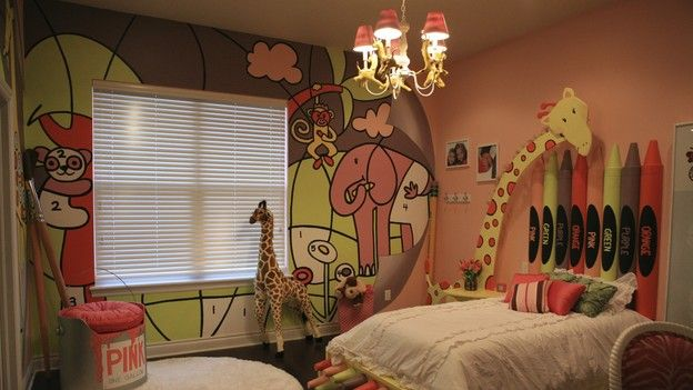 Cool child's room.  Paint by number wall, crayon headboard, paint can chair and 3-D giraffe night stand.