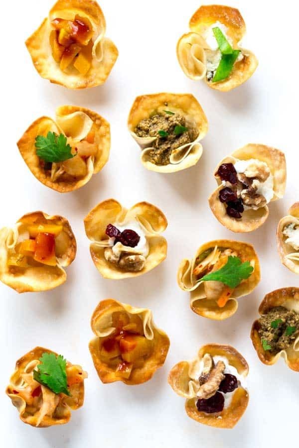 These homemade wonton cups take less than 30 minutes to make and are an easy appetizer Fill with chicken salad bbq pulled pork and more