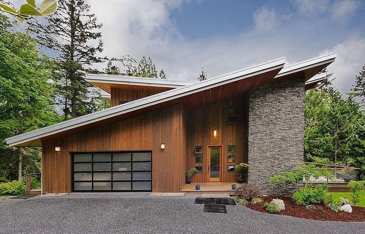 Dise o de casa moderna en la monta a rodeada de vegetaci n for Casa moderna design