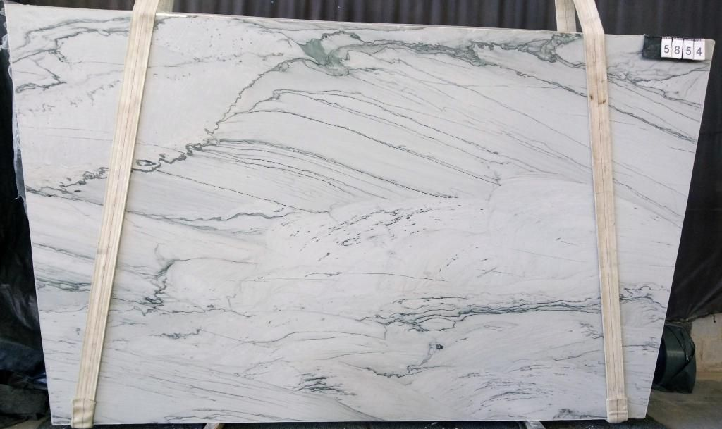 White Bright Strong And Uniquely Beautiful Infinity Quartzite Is The Newest Arrival At Stone Park Usa Inc Visi Quartzite Quartzite Countertops Stone Park