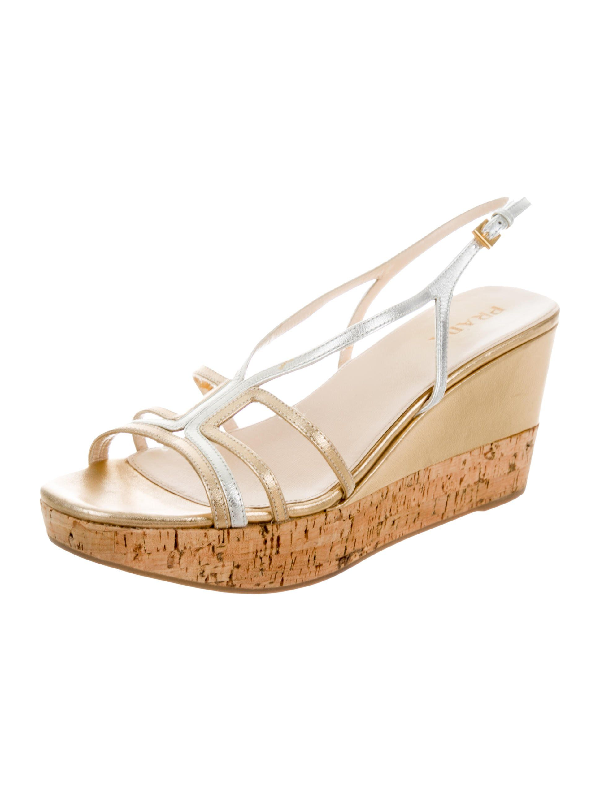 f5678de9eae8 Gold and silver-tone leather Prada wedge sandals with cork heels. Includes  dust bag.
