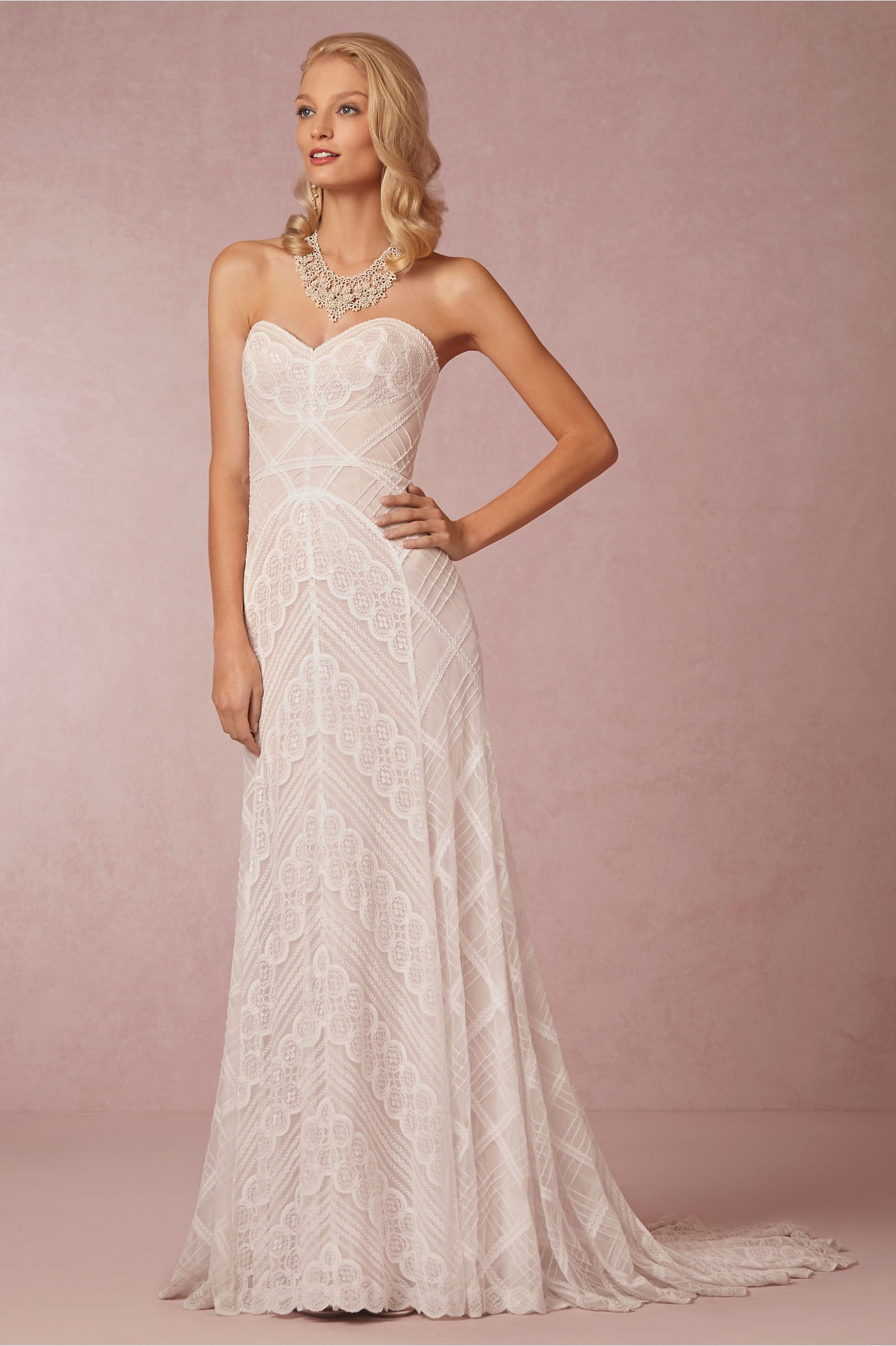 Gigi Gown Featuring A Strapless Neckline And Blush Lined Ivory Lace That Sweeps From