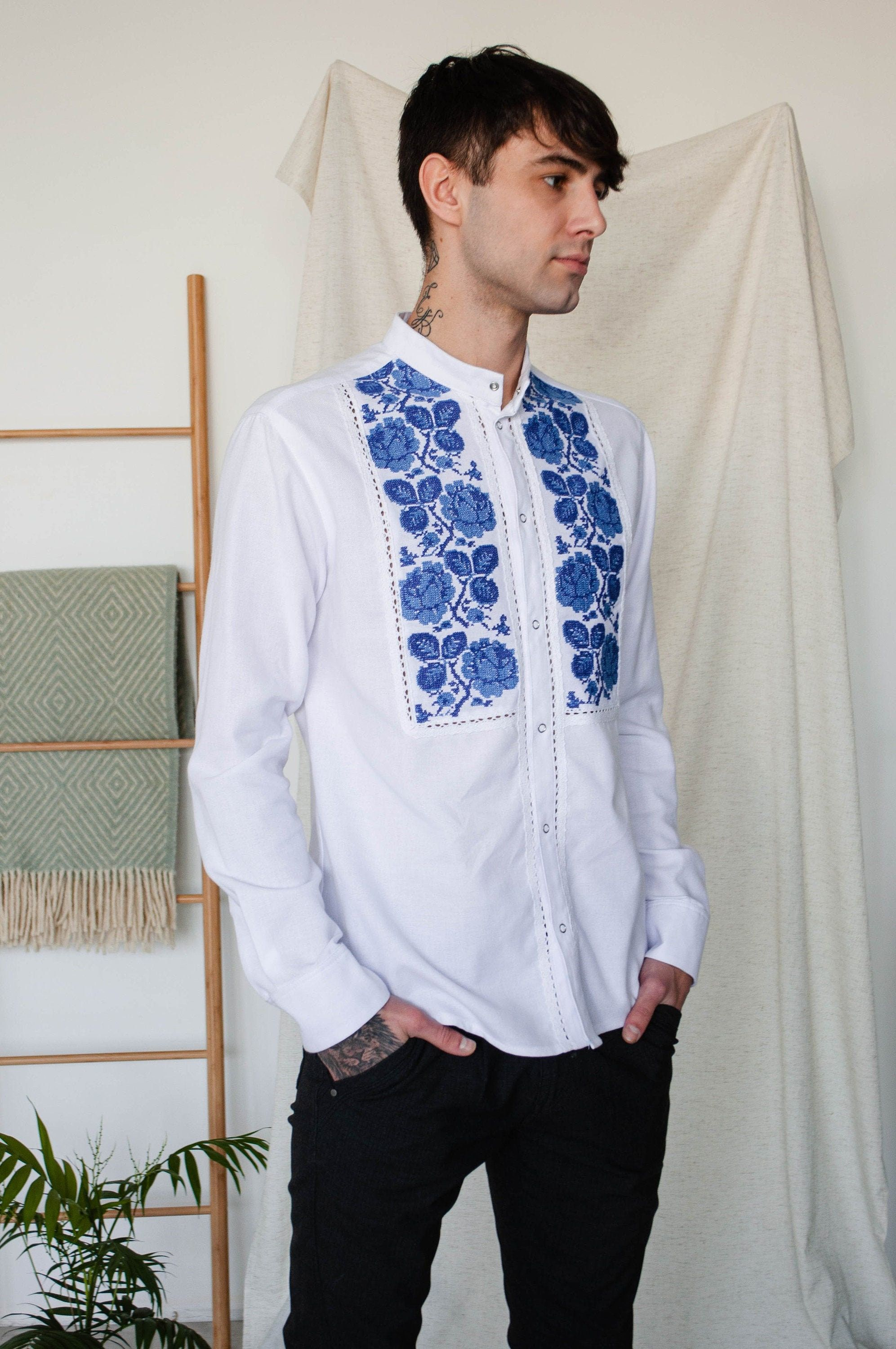 Floral embroidered folk shirt for men DESCRIPTION: ▪️ white cotton shirt with front snap buttons closure ▪️ decorated with cross stitch floral embroidery ▪️ white cotton lace inserts ▪️ band-collar ▪️ long sleeves finished with snap button Every item is handmade to order and to your body measurements (custom size). Also, you can choose between our standard size chart (check last picture) ♥Custom size♥ Everyone has a unique body. So in order to make the garment fit perfectly, once you have placed