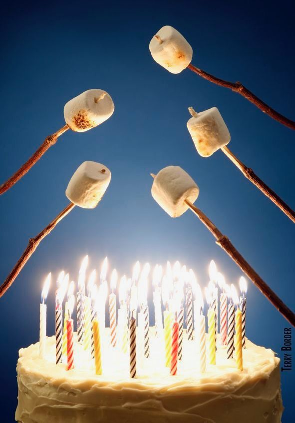 Happy Birthday roasting marshmallows over candles fire on cake