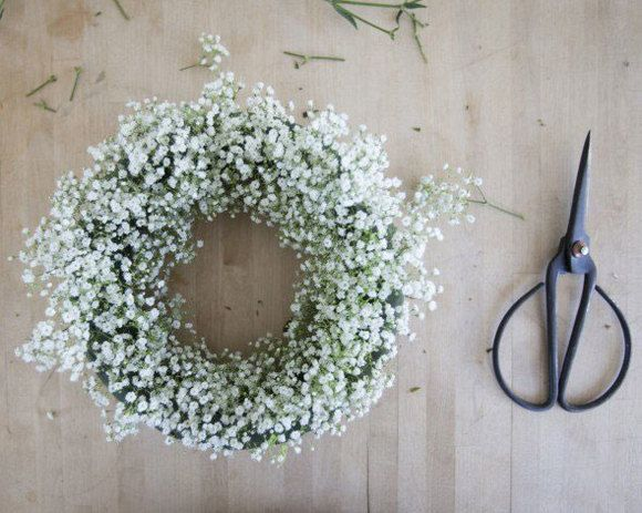 DIY baby's breath wreath for simple wedding decor.