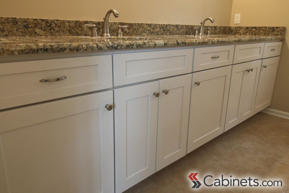 A Large Bathroom Vanity Featuring Our Titusville RTA Shaker Maple White  Cabinets