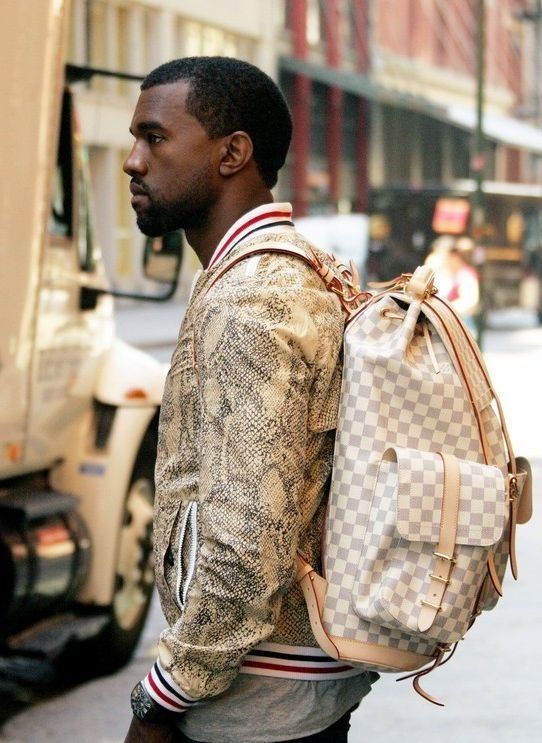 65aa6fc7b3cb Kanye West wears a Louis Vuitton Damier Azur Canvas Mountaineering Backpack