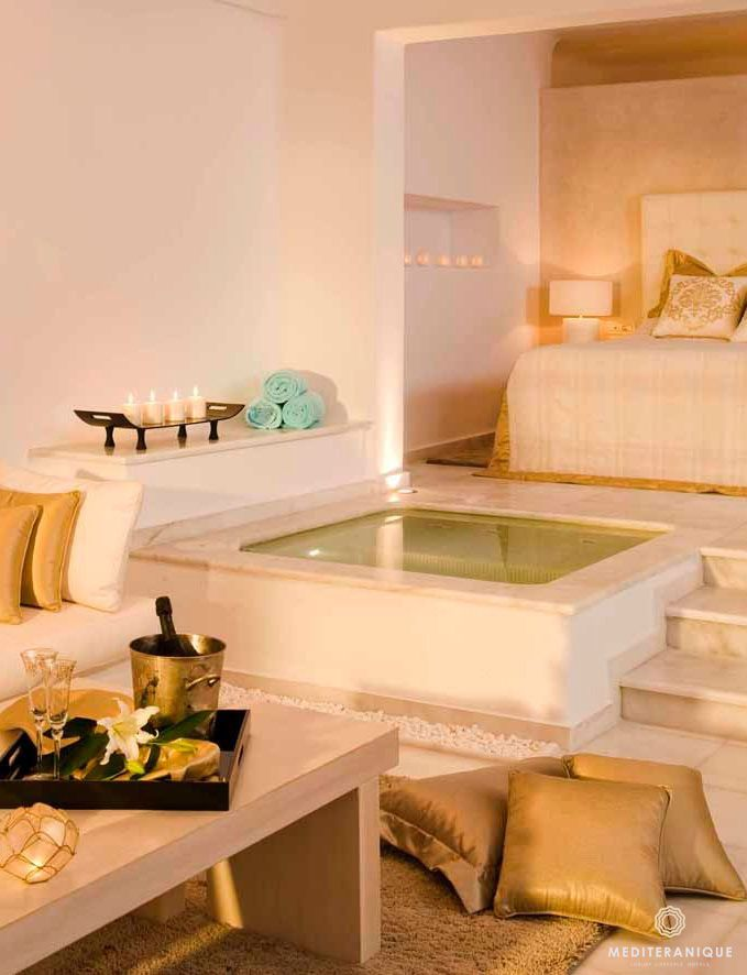A Luxurious Suite With An Indoor Jacuzzi At The Andromeda Gold Suites Santorini Luxury Hotel Room Hotel Interiors Indoor Jacuzzi