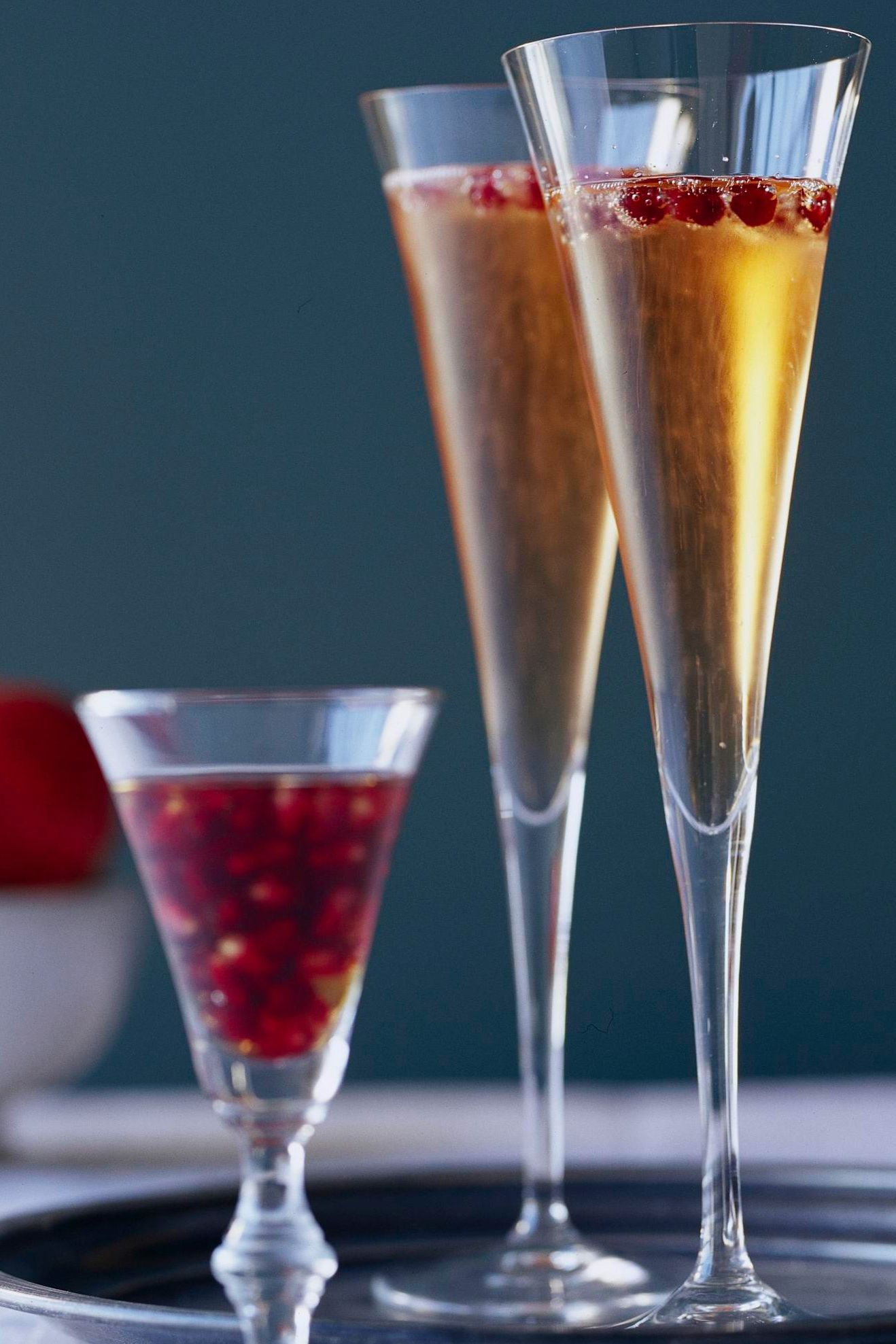 Bursting with tart pomegranate flavor, this bubbly beverage is one of our most popular champagne mixed drinks. #champagnecocktails #holidaycocktails #wintercocktails #easycocktailrecipes #drinkrecipes #bhg