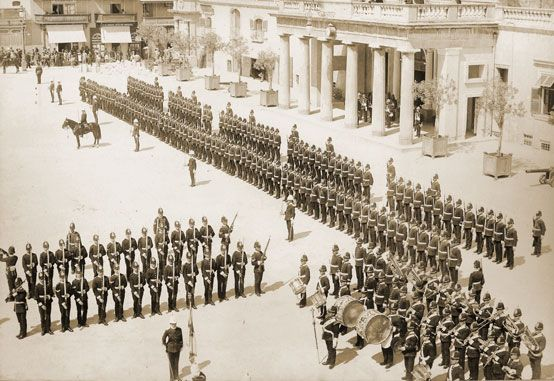 3rd (Militia) Battalion Loyal North Lancashire Regiment trooping the Colour, Malta, 1900    The 3rd (Militia) Battalion Loyal North Lancashire Regiment trooping the Colour in front of the Main Guard at Valletta, Malta, in 1900. The Militia battalions were mobilised for the duration of the Boer War, replacing Regular troops in overseas garrisons as well as serving in South Africa