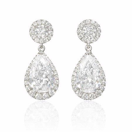 NEW: Diamond dangle earrings showcasing two beautifully matched pear shaped GIA certified white diamonds 4.22ctw and 46 prong set round brilliant cut white diamonds 1.36ctw crafted in 18k white gold #newyork #diamondjewelry #love #beautiful #firenzejewels