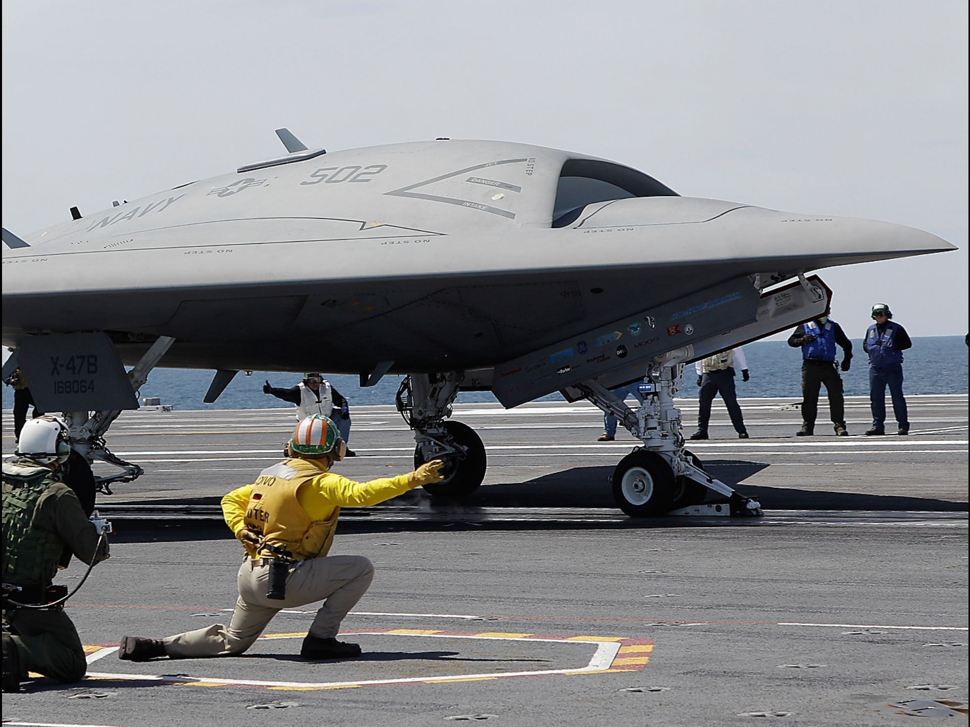 A U.S. Navy X-47B drone is prepared for launch on the USS George H. W. Bush off the coast of Virginia.