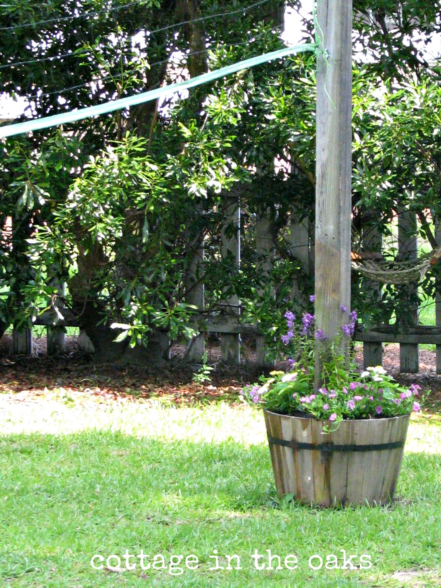 Making The Volleyball Net A Bit More Lovely Cottage In The Oaks Volleyball Court Backyard Backyard Diy Outdoor