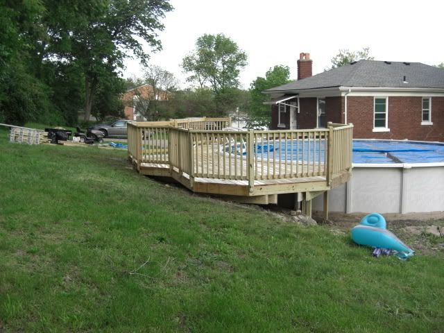 Like how this one goes into the hill pool in 2019 for Above ground pool decks for small yards